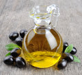Bottle of olive oil branch with olives and a Stock Images
