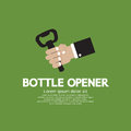 Bottle opener hand holding a Royalty Free Stock Images