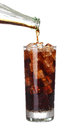 Bottle pouring coke in drink glass with ice cubes Isolated Royalty Free Stock Photo