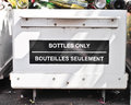 Bottle recycling a bin at a waste site Royalty Free Stock Photo