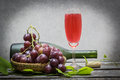 Bottle of red wine and grape Royalty Free Stock Photo