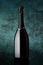 Bottle of sparkling wine on colorful blue background Royalty Free Stock Photo