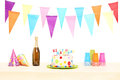 Bottle of sparkling wine plastic glasses party hats and birthday cake isolated on white background Stock Photography