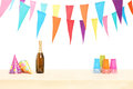 Bottle of sparkling wine plastic glasses and party hats isolated on white background Stock Photo