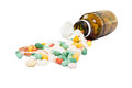 Bottle and spilled pills Royalty Free Stock Photo