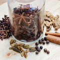 Bottle with various spices for mulled wine glass close up Royalty Free Stock Photos