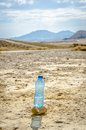 Bottle of water in desert the bardenas reales biosphere reserve landscape navarre Stock Images