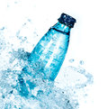 Bottle of water splash on a white background Royalty Free Stock Images