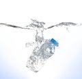 Bottle of water splash on white background Royalty Free Stock Photo