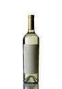 Bottle of white wine on white background with reflection vertical image an unopened isolated over Royalty Free Stock Image
