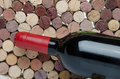 Bottle of wine on a background of corks red Royalty Free Stock Image