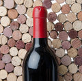 Bottle of wine on a background of corks red Stock Image