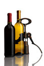 Bottle of wine with corkscrew on white background Royalty Free Stock Images