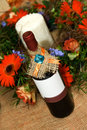 Bottle of wine with flower decoration red Royalty Free Stock Photos