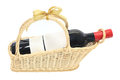 A bottle of wine on gift basket isolated white Stock Images
