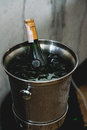 Bottle of Wine in ice bucket in a restaurant Royalty Free Stock Photo