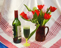 Bottle of wine and Spring tulips Royalty Free Stock Photo