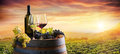Bottle And WineGlasses On Barrel In Vineyard Royalty Free Stock Photo