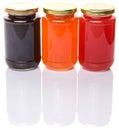 Bottled blueberry strawberry orange jam i and fruit Stock Image
