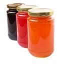 Bottled blueberry strawberry orange jam iii and fruit Royalty Free Stock Image