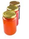 Bottled blueberry strawberry orange jam iv and fruit Royalty Free Stock Photography
