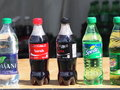 Bottled refreshments sitting on table in summer Stock Photo