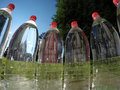Bottled water against a background of green nature Royalty Free Stock Image