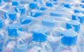 Bottled water bottles in plastic wrap rows of Royalty Free Stock Images