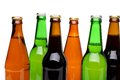 Bottlenecks and bottles of beer close up white background Stock Photography