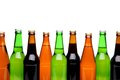 Bottlenecks and bottles of beer close up white background Stock Photos