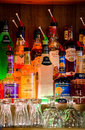 Bottles of alcohol on display many different kinds alcoholic drinks are at a local bar Royalty Free Stock Image