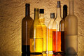 Bottles of alcoholic beverages Stock Images