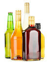 Bottles of assorted alcoholic beverages on white background Royalty Free Stock Images