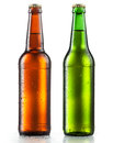 Bottles of beer with water drops on white background Stock Images