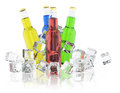 Bottles with colored drinks and ice cubes Royalty Free Stock Photo
