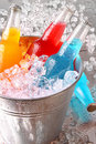 Bottles of cooler drinks with ice Stock Photography