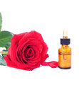 Bottles of essential oil and red rose Royalty Free Stock Photography