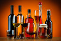 Bottles and glasses of alcohol drinks still life with various Stock Photo