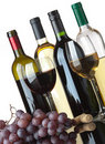 Bottles, glasses and grapes Royalty Free Stock Image