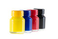 Bottles of ink in cmyk colors Royalty Free Stock Photo