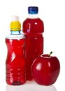 Bottles with juce and red apple Royalty Free Stock Photo