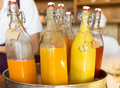 Bottles of juice in ice bucket at market Royalty Free Stock Photo