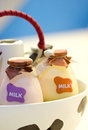 Bottles of milk in basket close up shot Royalty Free Stock Photos