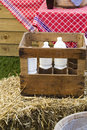Bottles of milk in wooden crate Royalty Free Stock Image