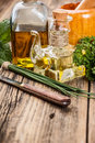 Bottles of olive oil with herbs in rustic setting Royalty Free Stock Images