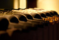 Bottles of red wine on a shelf Royalty Free Stock Photo