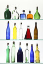 Bottles set of glass with colored liquids Stock Images