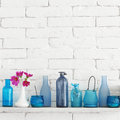 Bottles on a shelf decorative white brick wall with blue it Stock Images