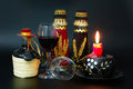 Bottles under the hat bottle of red wine decorated with spanish and slavonian small castanets fitted embellished with fabric and Royalty Free Stock Photos