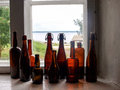 Bottles on the window Royalty Free Stock Photo